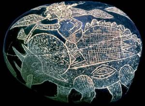 Dinosaurio y humano en piedra de Ica