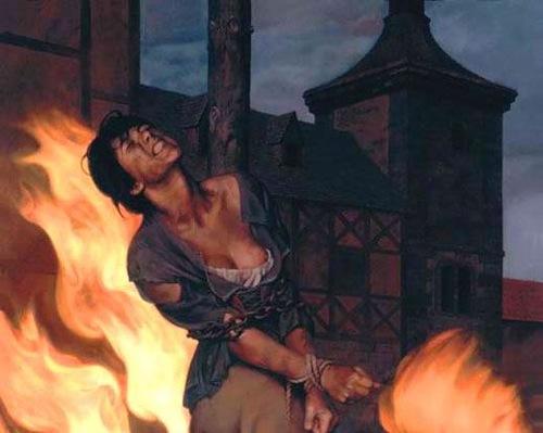 santa inquisicion torturando en la hoguera a mujer