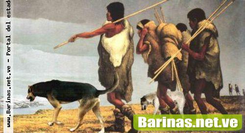 hombres primitivos y perros