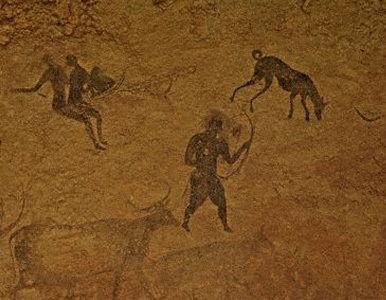 perros y hombres pintura rupestre